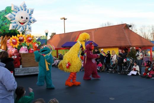 Start of parade along Sesame Street neighborhood at Sesame Place