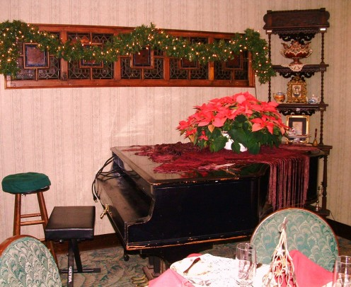 Baby Grand piano in Victoria's Restaurant decorated for Christmas and New Year's.