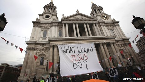 """Occupy potestestors with """"What Would Jesus Do?"""" slogan"""