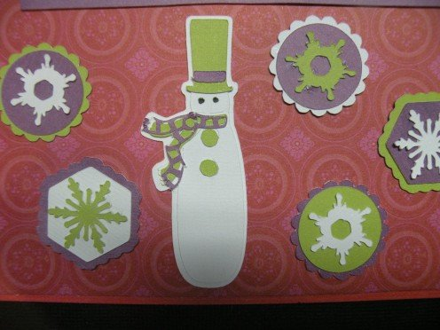Snowflakes adhered to card with snowman