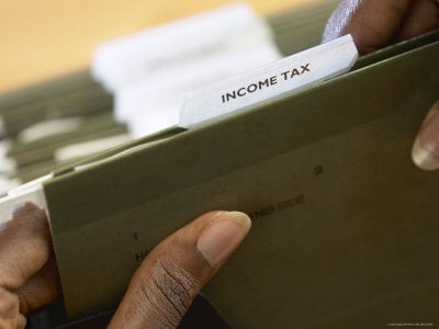 Woman Holding Income Tax Folder