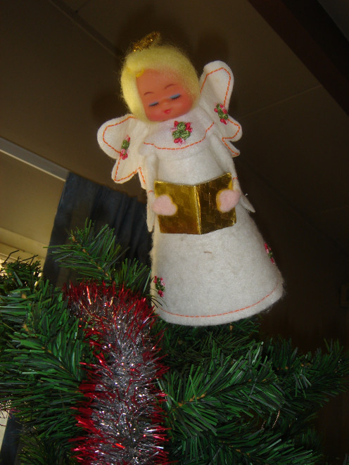 My Great Aunt Betty's Angel Christmas Tree Topper.  We love Aunt Betty, and will miss seeing her this Christmas, and everyone else.