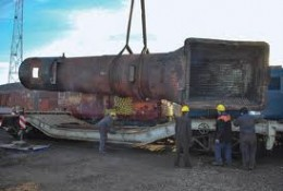 Machine wagon being loaded with boiler casting - these wagons were built originally for farm machinery and were diverted to tank transport in WWII