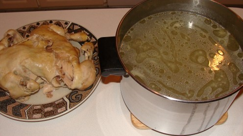 Chicken is removed and the broth is strained.