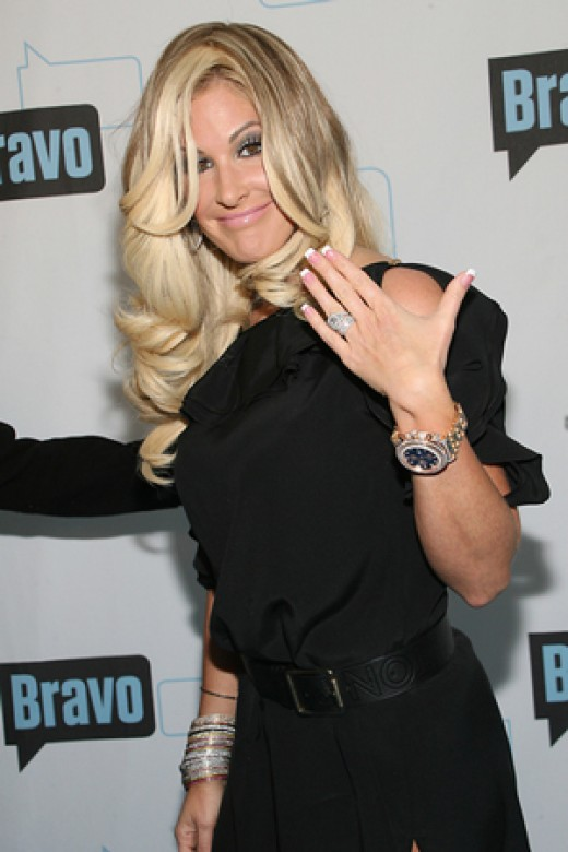 Kim Zolciak shows off the engagement ring given to her by Kroy Beirmmann