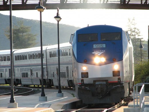 Despite attracting more passengers and revenues, Amtrak still faces efforts to slash its funding.