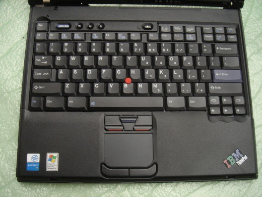 Keyboard and touch pad showing that this T42 had been rarely used.