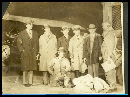Early aviation history, my guess is in the 1920's. The man in the flight suit is Ross Arnold.