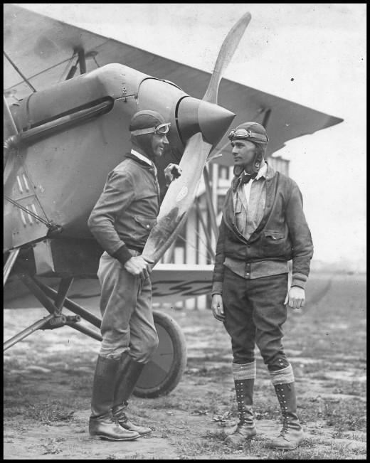 Ross Arnold (left) with unidentified man in flight gear. Unidentified location
