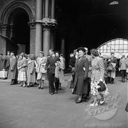 People at St Pancras Station gather perhaps to welcome relatives and friends in the 1950s, the post-war Austerity years