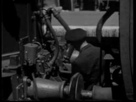 Locomotive crewman coupling up preparatory to taking out stock. In London termini - such as St Pancras - trains came in and pilot engines took away the empty stock to release the train engines