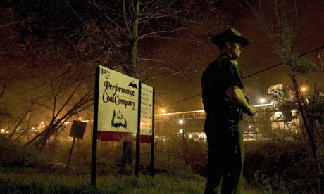 A police officer standing at the entrance to a mine owned by Massey Energy, just after the Upper Big Branch disaster, April 2010.