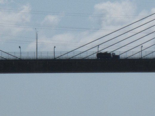 Truck crossing over the Panama Canal on the Centennial Bridge.