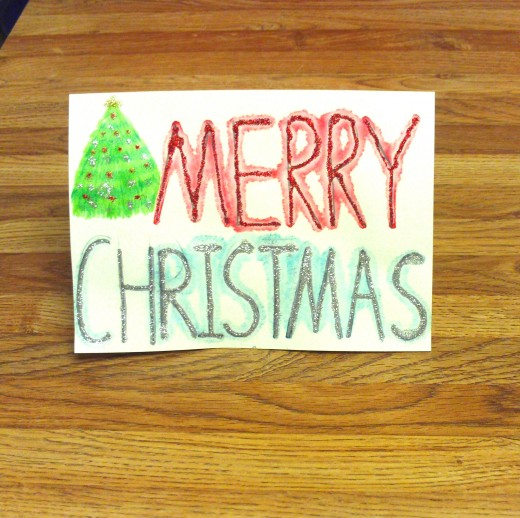 Here is a glittery Christmas card that I made with a Christmas tree accent.