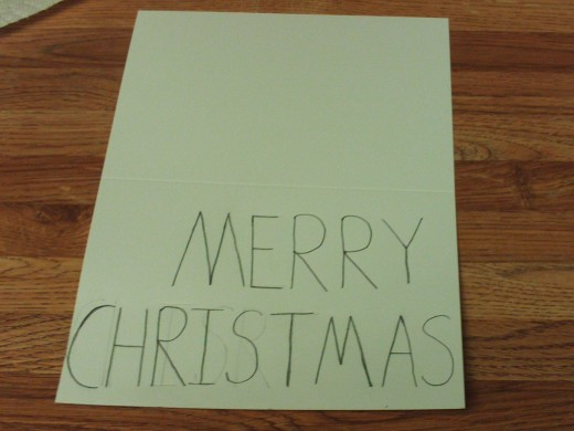 Here I am writing the text Merry Christmas on the front of the card.