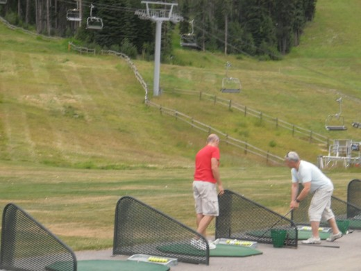 The driving range is near the bottom of the Sunburst Chairlift.