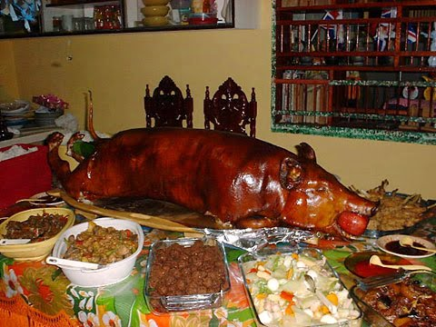 LECHON AND OTHER DELIGHTS. Most family tables teem with food during Christmas celebrations inviting family members to feast and be merry.
