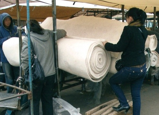 A roll of felt used to insulate a ger.