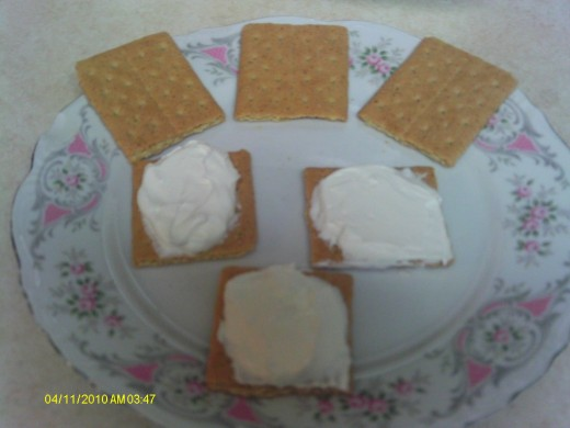 Putting the graham cracker sandwiches together in a matter of a few minutes.