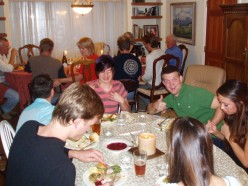 Holiday family meal - young people at one table, adults at another.