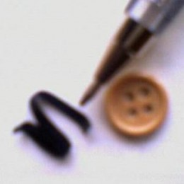 webcam image of 3 small objects on table top (webcam bar holder approximately    10.6_cms above table top). The small piece of plastic sheathed tie wire pointed at  by the ballpen is 3_mm in width including sheath. Button diameter is 11_mm.
