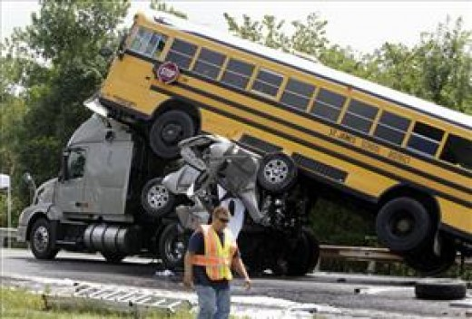 Pickup truck is between bus and big rig truck