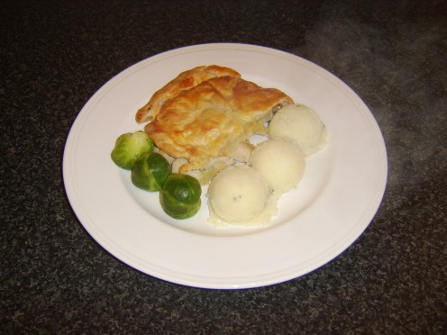 Chicken, leek and mushroom pie with minted mashed potatoes and Brussels sprouts