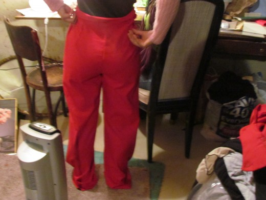 Jaleesa, poses the rear of these precious red pants. She is excited about the results.