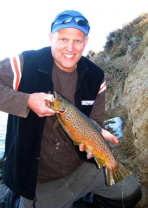 Angler David Griffin with a Beautiful Brown Trout caught in a Colorado Lake.