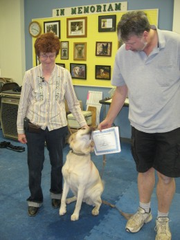 The star pupil being congratulated by her instructors for finishing the Beginning Obedience Class at the Alyeska Canine Training.