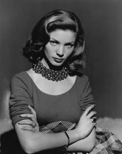 Lauren Bacall in rows of beads