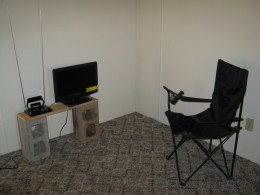 My living room. I would like to replace this chair with one perhaps a little more comfortable. But this one does work.