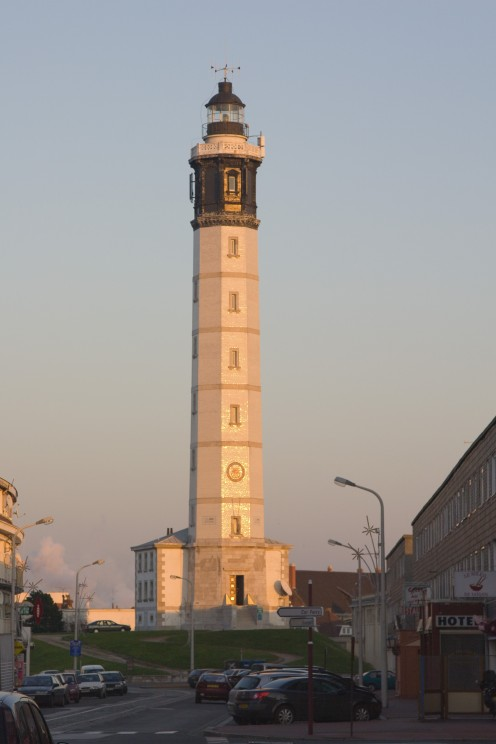 The Calais lighthouse, reflecting the sunset.