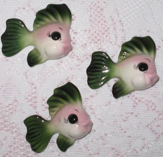 These three vintage Freeman McFarlin Originals baby fish go with the large vintage mermaid wall pocket.  They are also in excellent condition and all three still have their stickers on their backs.