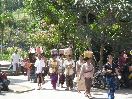 Devoted Balinese heading to the sacred spring and temple of Tirta Empul. Ancient Sites around Ubud, Bali, Indonesia.