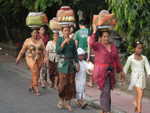 Devoted women of Ubud dressed in traditional attire. Streets of Ubud, Bali, Indonesia.
