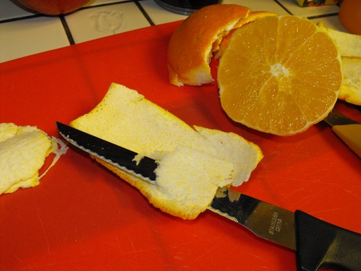 Use a sharp serrated knife to cut the white pith away from the rind
