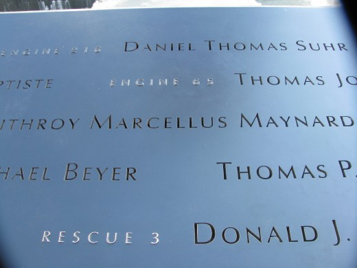 Close up of names rimming one of the Reflecting Pools.