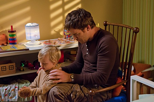 "Hall bonds with his son on ""Dexter."""