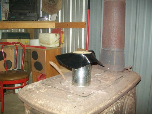 the melt down begins! note the home made speaker boxes contained within the shelves of my awsom red-neck shop.
