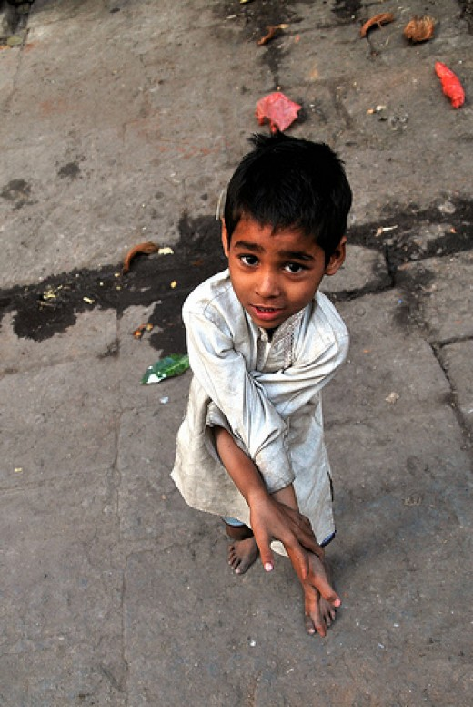 Poor boy on the street from Arek Jablonski Source: flickr.com