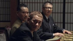 "The great direcot/actor Takashi ""Beat"" Kitano is in the front.  He plays the representation of logic and in my opinion is greatly underused in the film."