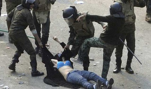 This female protester was half-stripped, beaten and stomped on.