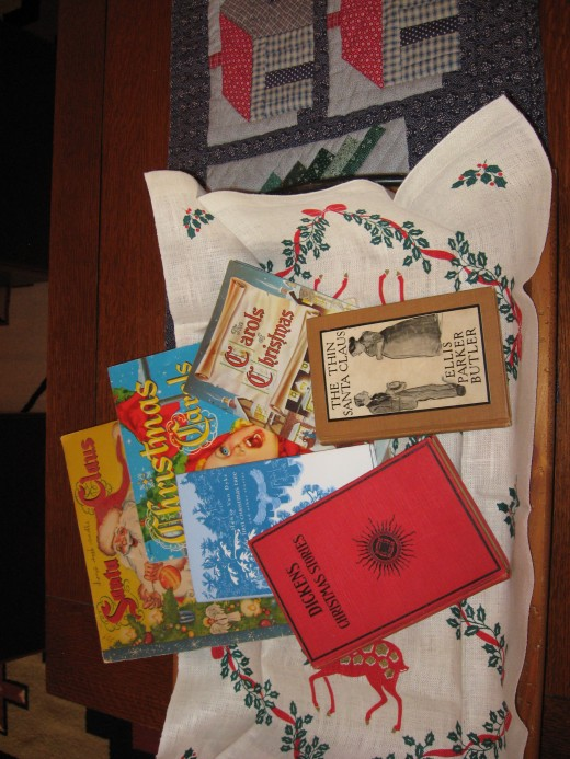 Various books displayed in tray with vintage linen
