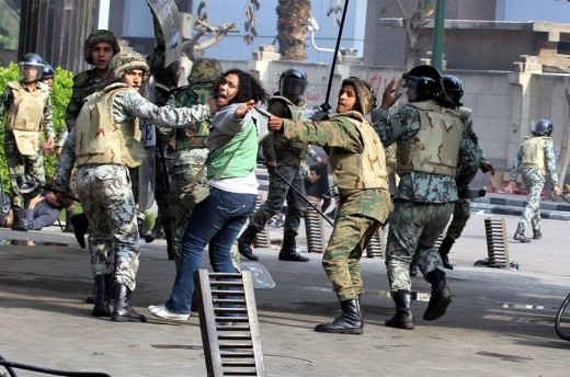 This woman seems to be pleading for help as she is being dragged away by Egyptian soldiers.
