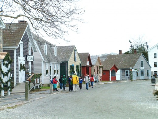 Photo of group of school children touring the Mystic Village shops.