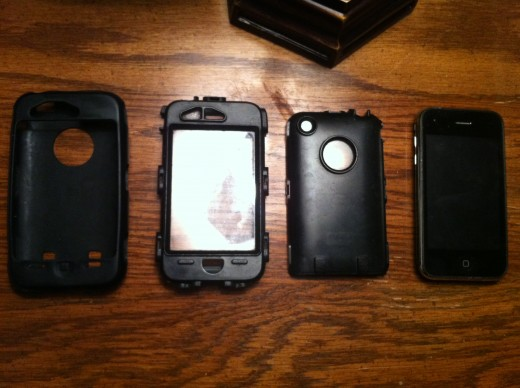 The iPhone 3G / 3GS sitting outside of both the silicone shell and the hard plastic case that make up the OtterBox Defender.