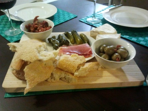I can survive with just cheese, olives, sundried tomatoes, prosciutto or other cold cuts. :)
