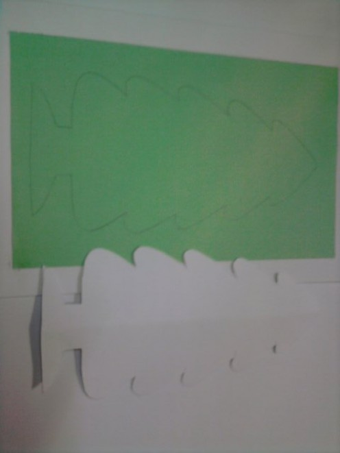 Draw the outline of the Christmas tree on the front white card.