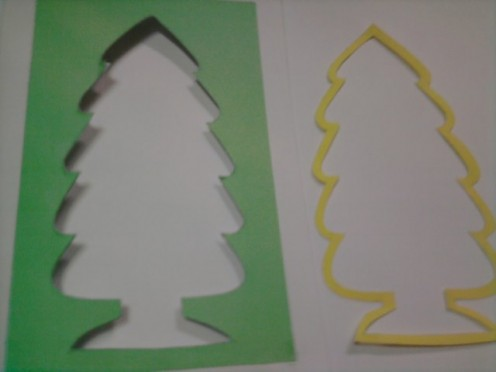 Draw the shape of the tree on the yellow paper. Thicken the outline of the tree shape by 1/2 inch. Cut out the shape.